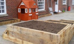 Wooden Decking and Play House -Landscape Gardeners in Lincolnshire